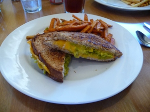 Grilled Cheese with Green Chilies, Avocado, Cheddar Cheese on wheat,  side of sweet potato fries