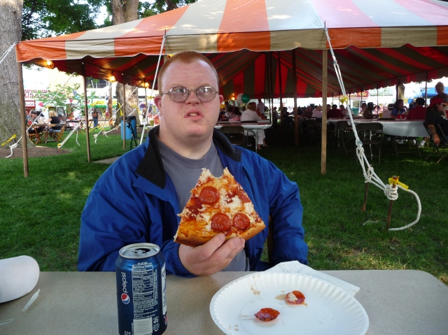 Andy had a BIG piece of pizza, but he's mad because he didn't want his picture taken!