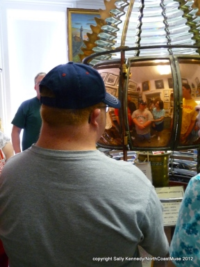 Andy reflected in the Fresnel lens, Fairport Harbor Lighthouse Museum, Fairport Harbor, Ohio