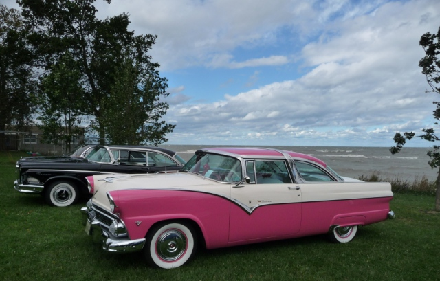 "The great sky behind this pink and white Ford Crown Victoria invokes ""beyond"""