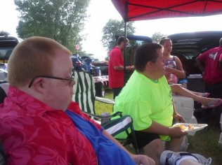 Andy and his friend, Merle, enjoy pizza before the parade